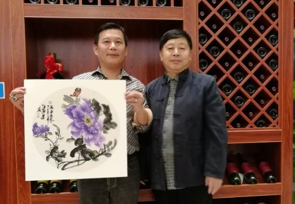 张惠民画家与广西晓狮、广西爱晚之家总经理合影